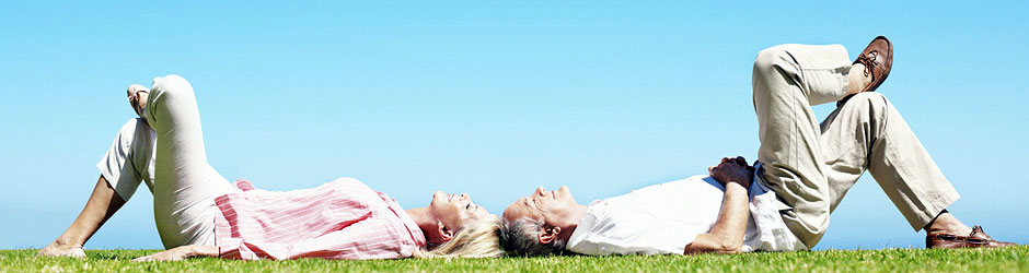 couple-relaxing-on-field